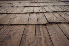Natural pine wood panels from a wooden roof of a mountain stable Royalty Free Stock Photo