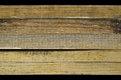 Natural pine wood plank texture. Grain, cover. Isolated on black background royalty free stock photos