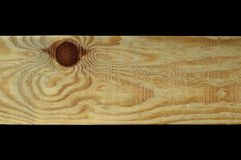Natural pine wood plank texture. Grain, cover. Isolated on black background royalty free stock image