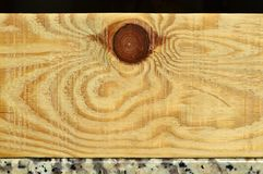 Natural pine wood plank texture. Grain, cover. Isolated on black background royalty free stock photography