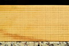 Natural pine wood plank texture. Grain, cover. Isolated on black background stock images
