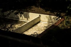 Empty pool in a park sunlight royalty free stock photography