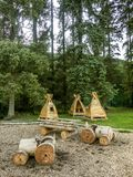 Natural play area forestry wooden woods woodland. Childrens wooden outdoor play area quiet unused Stock Photography