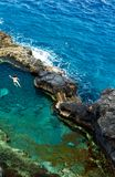 Natural pool. Woman bathing in the natural pool Charco Azul, La Palma, birdsview stock image