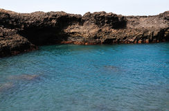 Natural Pool. Baia - A natural bay formed by volcanic lava from past eruptions with natural arch surrounded by the blue waters of the Atlantic creating a natural Stock Photo