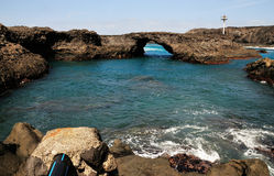 Natural Pool of Baia and its Arch. Baia - A natural bay formed by volcanic lava from past eruptions with natural arch surrounded by the blue waters of the Stock Images