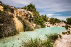 Natural pool in etruscan spa Bagno Vignone Stock Photo