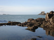 Natural pool in Saint Malo. With a fort in background, 2007 Royalty Free Stock Photography