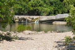 A natural pool and 3 small waterfalls