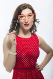 Natural Portrait of Caucasian Brunette Woman With Artistic Spectacles. In Front Of Face.Against White. Vertical Shot Stock Images