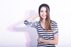Natural Portrait of Curious Caucasian Brunette Girl Touching Hat Royalty Free Stock Photography