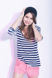 Natural Portrait of Cute and Smiling Slim Caucasian Brunette Girl in Hat and Striped Shirt. Royalty Free Stock Photo