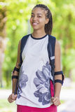 Natural Portrait of Happy Positive African American Teenage Girl. Posing Outdoors in Park. Stock Photos