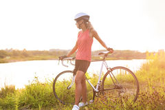 Natural portrait of young serene caucasian female cyclist having Royalty Free Stock Image