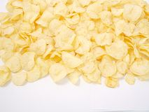 Natural potato chips golden on a white background royalty free stock images