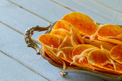 Natural potato chips heap the bowl on wood background royalty free stock photos