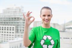 Natural pretty environmental activist making okay gesture Royalty Free Stock Image