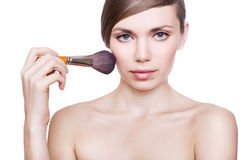 Natural pretty woman with cosmetic brush Royalty Free Stock Image