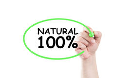 Natural 100 procent. Text write on transparent wipe board by hand holding a marker Stock Photography