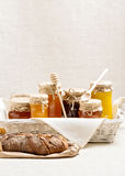 Natural product. Different types of honey and homemade bread. Royalty Free Stock Photo