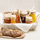 Natural product. Different types of honey and homemade bread. Royalty Free Stock Images