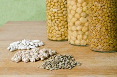 Natural product or product packaging canned?. Comparison of natural products and packaged products, legumes Stock Images