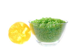 Natural products for aroma bath. Green salt in transparent dish and scrubbing soap Stock Photography