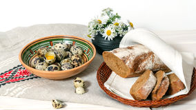 Natural Products. Quail eggs and homemade bread on the table Royalty Free Stock Photo