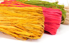 Natural raffia of different colors Stock Photos