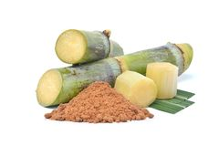 Natural raw sugar made from organic sugar cane. With Fresh green Sugarcane trunks isolated on white background royalty free stock photography