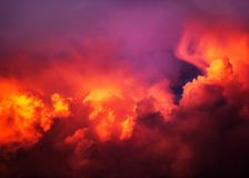 Red Sunlight and Clouds. Natural Red Dramatic Clouds Area Background Stock Photography