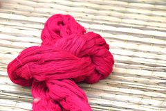Natural red dyed yarns yarn as textile fiber. For weaving Royalty Free Stock Image