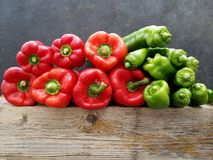 Natural red and green peppers on old wood Royalty Free Stock Photo