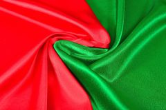 Natural red and green satin fabric texture royalty free stock images