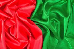 Natural red and green satin fabric texture royalty free stock photo