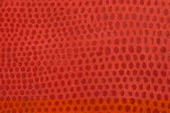 Natural red leather background. Closeup Stock Photo