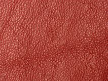 Natural red leather texture background. Genuine material Stock Photo
