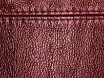 Natural red leather texture background with seam. Genuine material Royalty Free Stock Images