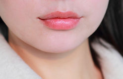 The natural red lips. Asian women's natural  red lips Royalty Free Stock Photo