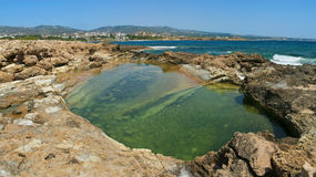 Natural reservoir with clear water at Coral Bay beach. Natural reservoir with transparent water at Coral Bay beach in Cyprus Royalty Free Stock Image