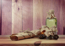 Natural resources for beauty and health. An ancient scroll with royalty free stock photography