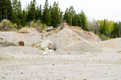 Natural resources in esker. Removal of esker for use as natural resources. Deposits layed down in latest iceage by nature. Naturaly rounded stones and gravel Stock Photos
