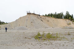 Natural resources in esker. Removal of esker for use as natural resources. Deposits layed down in latest iceage by nature. Naturaly rounded stones and gravel Stock Photography
