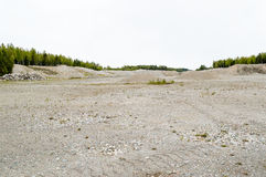 Natural resources in esker. Removal of esker for use as natural resources. Deposits layed down in latest iceage by nature. Naturaly rounded stones and gravel Royalty Free Stock Photo