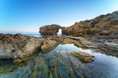 Natural rock arch, cliff and beach. Natural rock arch, cliff and beach in California, USA Royalty Free Stock Photos