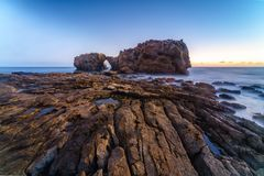Natural rock arch, cliff and beach. Natural rock arch, cliff and beach in California, USA Stock Photography