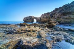 Natural rock arch, cliff and beach. Natural rock arch, cliff and beach in California, USA Royalty Free Stock Image