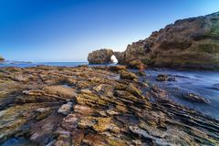 Natural rock arch, cliff and beach. Natural rock arch, cliff and beach in California, USA Stock Photos