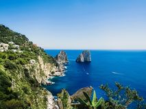 Free Natural Rock Arches And Cliffs On The Coast Sorrento And Capri, Italian Islands With Crystal Clear Waters Where Tourist Boats Royalty Free Stock Images - 168000699
