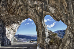 Natural rock arches in provence mountain road Royalty Free Stock Photo
